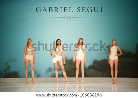 CANARY ISLANDS -JUNE 23: Unidentified models walks the runway in the Gabriel Segui collection during Gran Canaria Moda Calida swimwear fashion show on June 23, 2012 in Canary Islands, Spain - stock photo