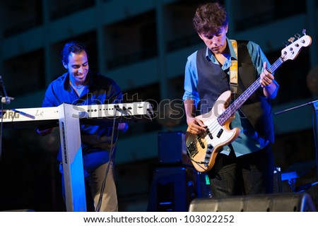 CANARY ISLANDS, SPAIN MAY 18: Jorge Scandelion (l) and Marco Tejera(r) in The Mars Cats, from Gran Canaria, perform onstage during Condenados Rock on May 18, 2012 in Canary Islands, Spain - stock photo