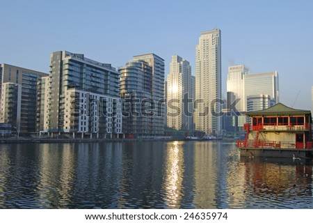 Canary Wharf skyline and South Dock, London, England - stock photo
