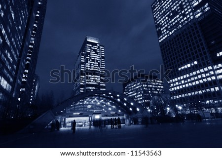 Canary Wharf underground station among skyscrapers in London - stock photo
