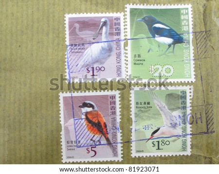 Canceled postage stamps with package wrapper from Hong Kong