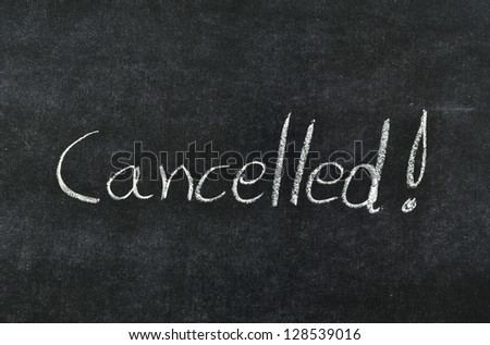 cancelled written with chalk on blackboard