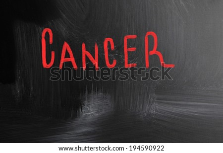 cancer handwritten with chalk on a blackboard - stock photo