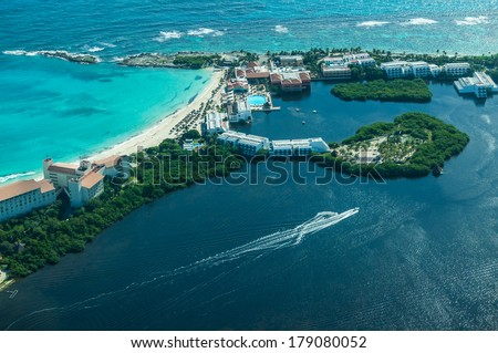 Cancun (Mexico) from bird�s eye view (Cancun's beaches with luxury hotels and  turquoise Caribbean sea and dark lagoon with stunning isles and yachts) - stock photo