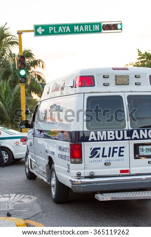 Cancun, Mexico - 2 January 2016: Ambulance car at the street road with blinking lights. Car accident