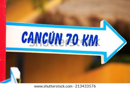 Cancun wooden direction signpost, Yucatan, Mexico - stock photo
