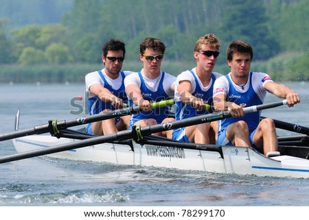 CANDIA, TURIN, ITALY - MAY 22: the Coxless four (straight four) (4-) CUS Torino crew rowing during 2011 Rowing CNU University National Championship on May 22, 2011 on Candia lake, Turin, Italy - stock photo
