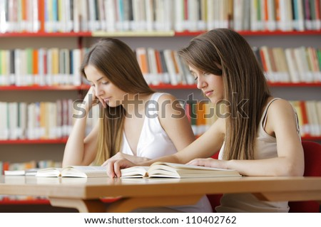 Candid capture of a pair of university students in the college library