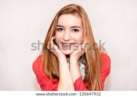 candid portrait of a girl with braces, isolated on white background - stock photo