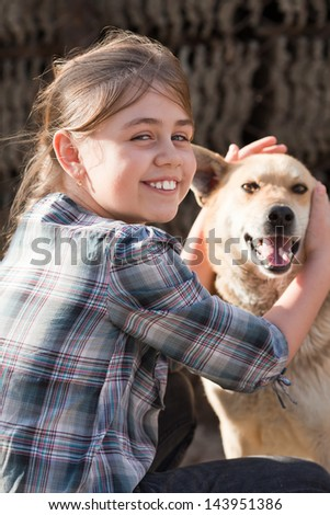 Candid young girl holding stray dog. Positive feeling
