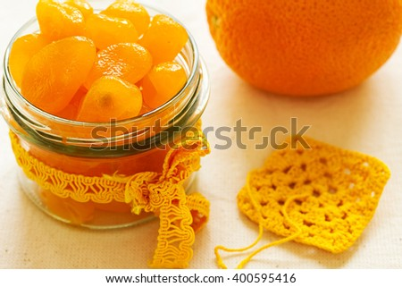 Candied kumquat. Candied citrus fruits. Home canning fruit. - stock photo