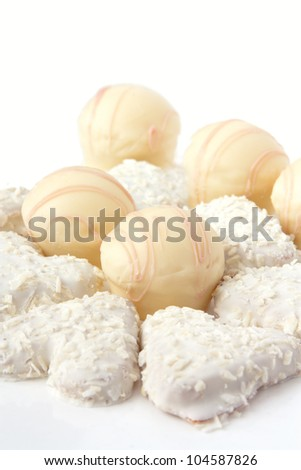 candies and cookies in white chocolate close up - stock photo