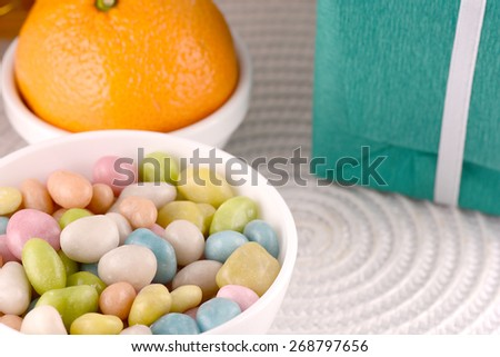 candies, gift box and fruits - stock photo