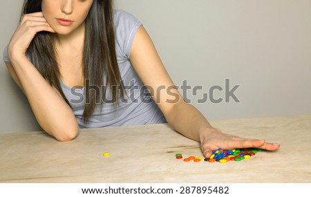 candies in woman hand - stock photo