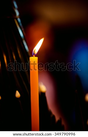 Candle  and   Banana folded leaves and flowers during wrist-binding ceremony - stock photo