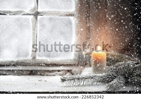 candle and snow  - stock photo