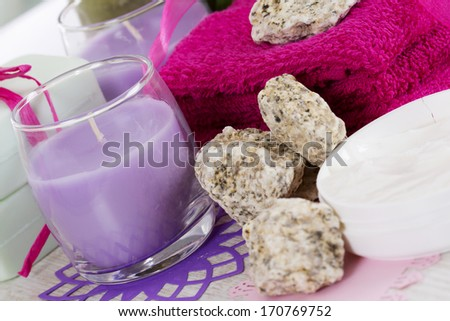 Candle and towels in health spa for spa treatment.