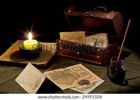 Candle and vintage money - stock photo