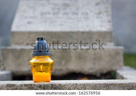 candle at a cemetary  - stock photo