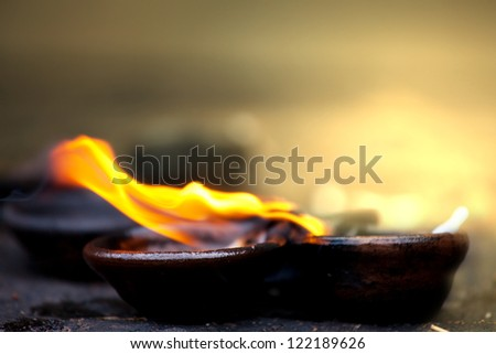 Candle at buddhist temple - stock photo
