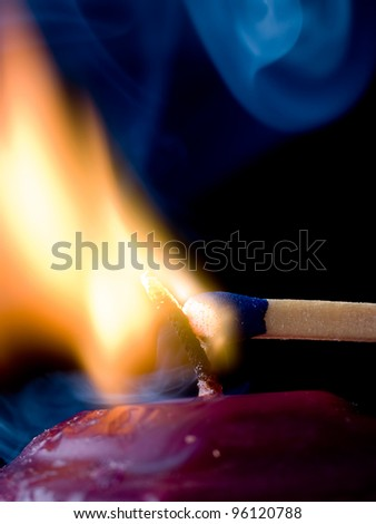Candle Flame ignites a sulfur match-head - stock photo