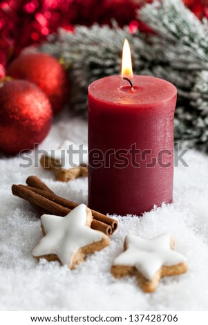 candle for christmas with cookies - stock photo