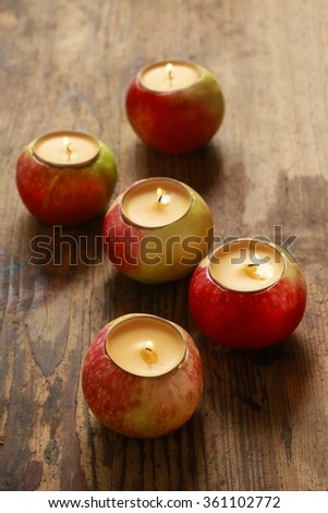 Candle in apple - beautiful table decoration - stock photo