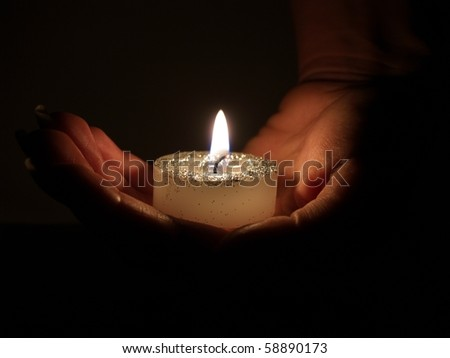 candle in hand - stock photo