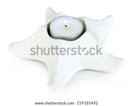 Candle in starfish isolated on white - stock photo