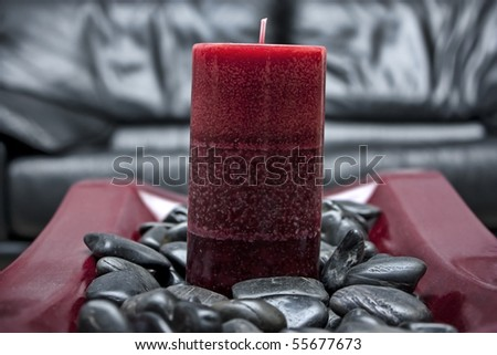 Candle in stones - stock photo