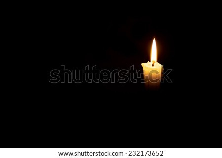 Candle in the dark  - stock photo