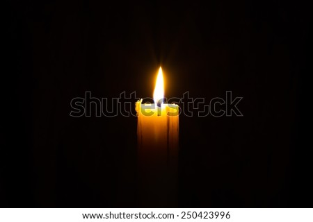 Candle in the dark with copyspce - stock photo