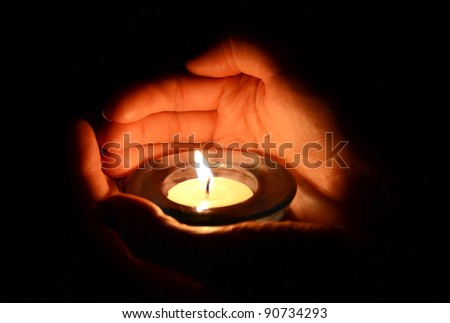 Candle in the hand - stock photo