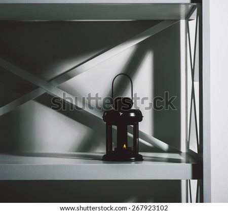 candle lamp on the shelf in the design of the design of flats, vertical photo for the theme of interior space. - stock photo