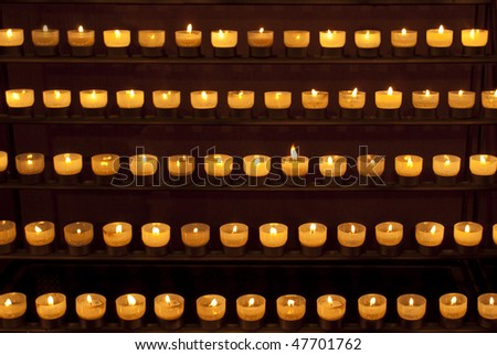 Candle light in a church - stock photo