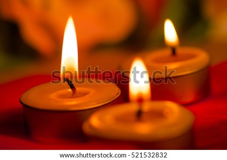 candle light with flame close up still life and vintage style