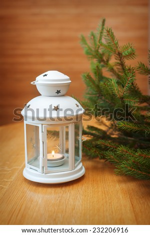 Candle lighting in a white candle holder. - stock photo