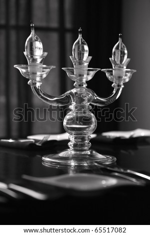 Candle lights on the table in the restaurant, b&w - stock photo