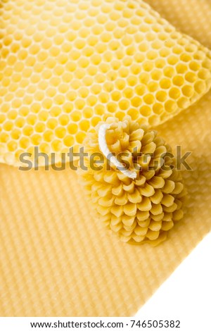 Candle Made Of Beeswax On A Comb