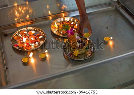 Candle offering on a hindu temple - stock photo