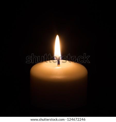 Candle on black background - stock photo