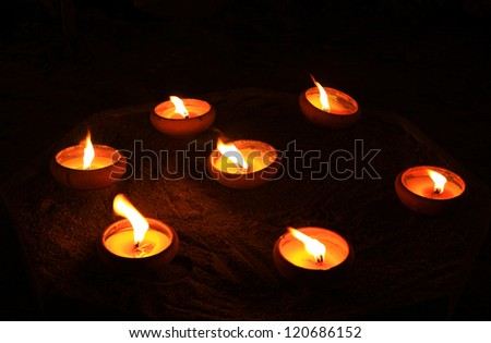 Candle on sand - stock photo