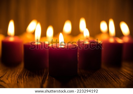 Candle on wood background - stock photo