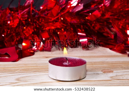 Candle on wood with Christmas decorations