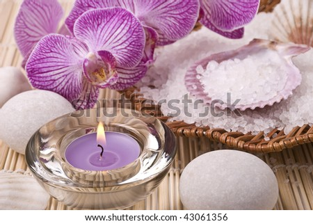Candle, salt,stones and orchid