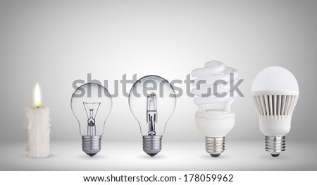 Candle, tungsten bulb,fluorescent,halogen and LED bulb - stock photo