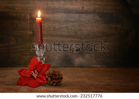 candle with poinsettia flower - stock photo