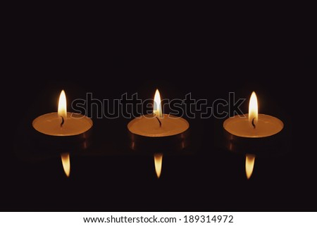 Candlelight - Isolated on Black Background - 3 Candles - stock photo
