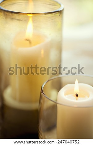 Candles add ambiance as the evening hours approach.  - stock photo