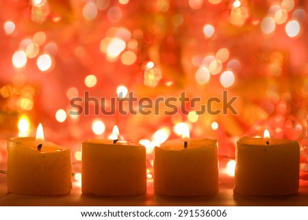 Candles against broken lights decoration background festive atmosphere